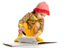 Little girl learn to paint in the album. Royalty Free Stock Photo