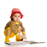 Little girl learn to paint in the album. Royalty Free Stock Photography