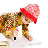 Little girl learn to paint in the album. Stock Photo