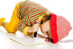 Little girl learn to paint in the album. Stock Photos