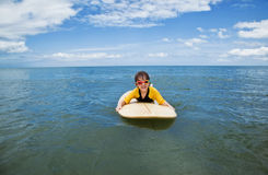 Little girl learn to surf at ocean. The Little girl learn to surf at ocean stock photo