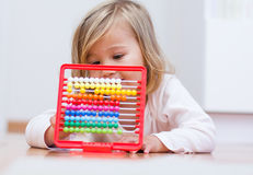 Little girl learning with abacus Stock Images