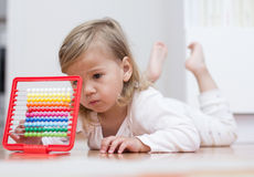 Little girl learning with abacus Royalty Free Stock Photography