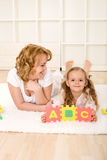 Little girl learning the alphabet Royalty Free Stock Photography