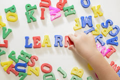 Little girl learning alphabet letters Royalty Free Stock Images