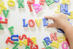 Little girl learning alphabet letters Royalty Free Stock Photo