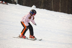 Little girl learning alpine skiing Stock Photography