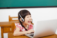 Little girl learning computer in classroom Royalty Free Stock Photos