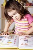 Little Girl Learning Figures and Letters Stock Photo