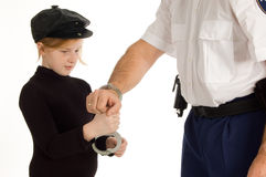Little girl is learning how to arrest a person. On white royalty free stock photos