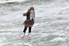 Little girl learning ice skating Stock Photo