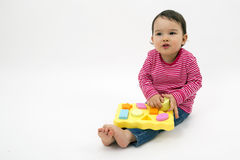 Little girl learning shapes, early education and daycare concept. Isolated stock photo