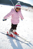 Little girl learning skiing royalty free stock image