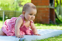 Little girl learning to crawl Stock Images