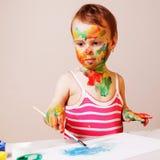 Little girl learning to paint child development in art Stock Images
