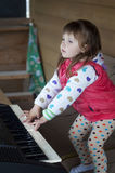Little girl learning to play piano. Concept of music study and creative hobby Stock Images