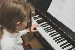 Little girl play the piano royalty free stock photography