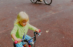 Little girl learning to ride first bike Stock Photography