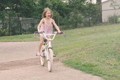 Little girl learning to ride her new bike Royalty Free Stock Photography