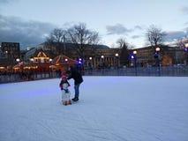 Little girl learning to skate. Christmas markets of Stuttgart. stock photos