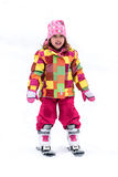 Little girl is learning to ski in ski resort Stock Photography