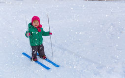 Little girl learning to ski in winter Stock Photo