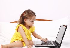 Little girl learning to use a laptop keyboard Royalty Free Stock Photos