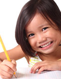 Little girl learning to write. Asian toddler learning to write Royalty Free Stock Photography