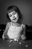 Little girl learns to make dough Stock Images