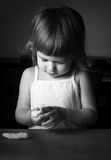 Little girl learns to make dough Royalty Free Stock Images