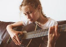 Little girl play guitar. Royalty Free Stock Photo