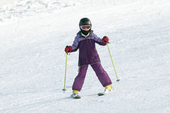 Little girl skiing Stock Photo