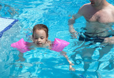 Little girl learns to swim Royalty Free Stock Image
