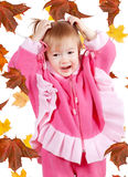 Little Girl with leaves Stock Photo