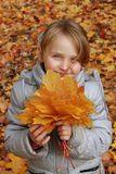 Little girl with leaves Royalty Free Stock Images