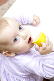 Little girl with lemon Royalty Free Stock Photo