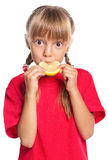 Little girl with lemon Royalty Free Stock Image