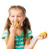 Little girl with lemon Royalty Free Stock Photos