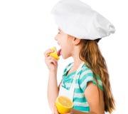 Little girl with lemon Stock Images