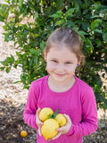 Little girl with lemon Royalty Free Stock Photos