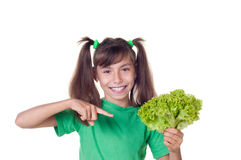 Little girl with lettuce Royalty Free Stock Image