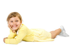 Little girl lias upon floor. Royalty Free Stock Photo
