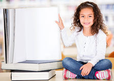 Little girl at the library Royalty Free Stock Photo