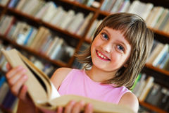 Little girl in a library Royalty Free Stock Image