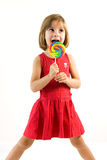 Little girl licking a lollipop Stock Photo