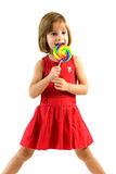 Little girl licking a lollipop Royalty Free Stock Photos