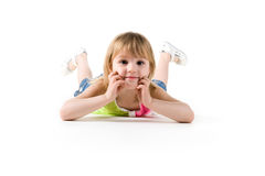 Little girl lie on the floor Royalty Free Stock Photo