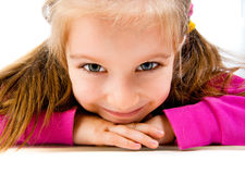 Little girl lie on the floor Stock Photo