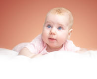 The little girl lies on a pillow Royalty Free Stock Image