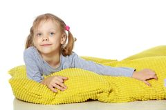 A little girl lies on a pillow. Concepts of family happiness, people, child, Healthy sleep, beauty and relaxation. Isolated on white background stock photography